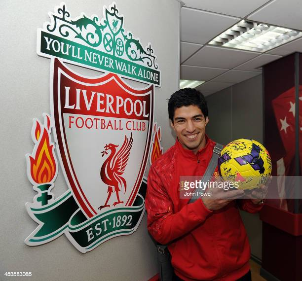 Luis Suarez of Liverpool celebrates with the hat trick ball after the Barclays Premier League match between Liverpool and Norwich City at Anfield on...