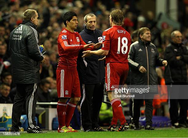 Luis Suarez of Liverpool comes on as a substitute for Dirk Kuyt during the Barclays Premier League match between Liverpool and Tottenham Hotspur at...
