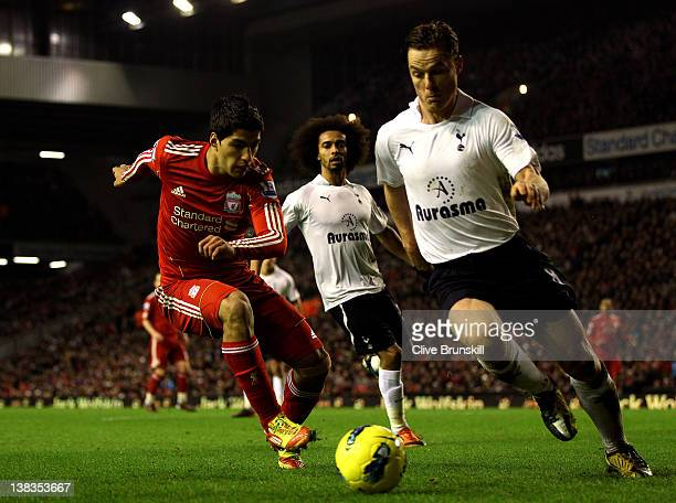 Luis Suarez of Liverpool competes with Scott Parker of Tottenham Hotspur during the Barclays Premier League match between Liverpool and Tottenham...