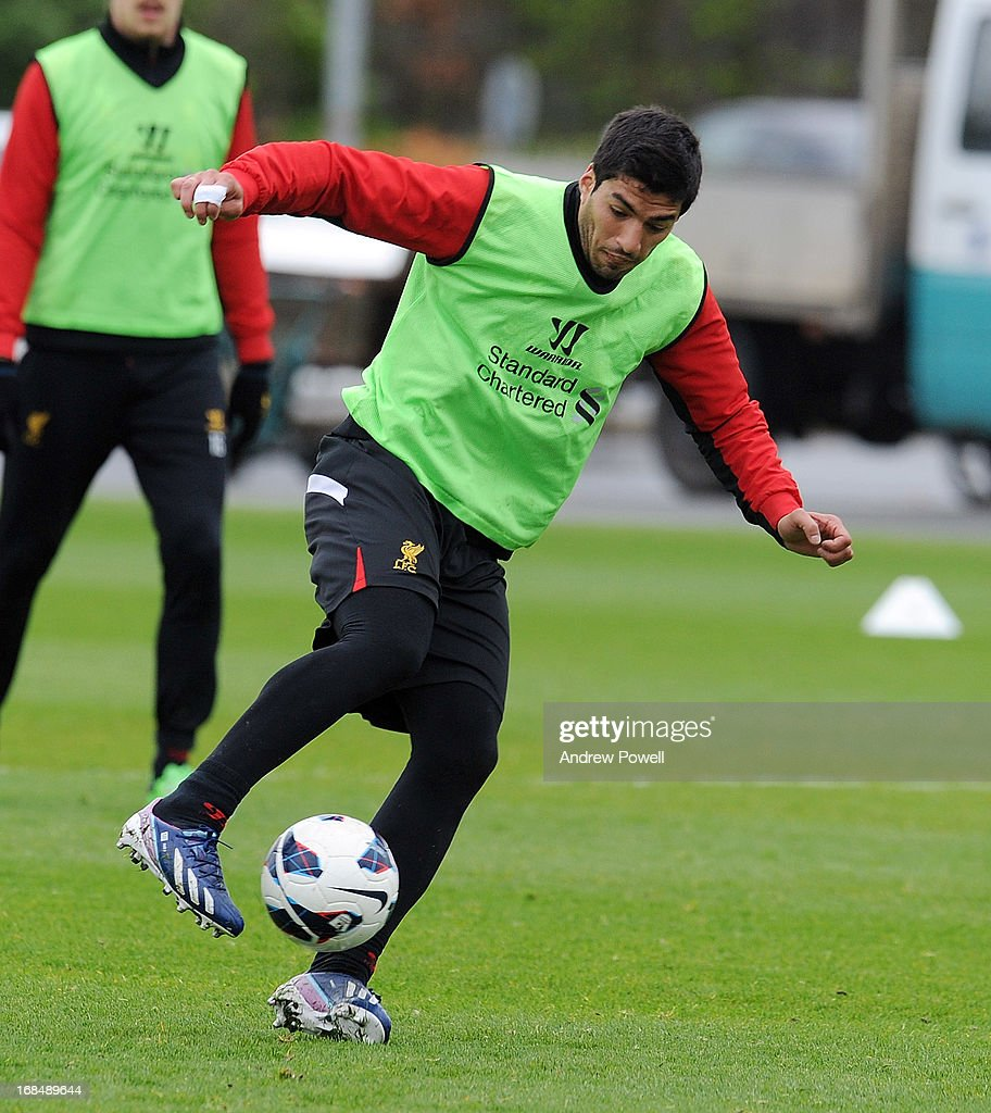 Luis Suarez of Liverpool controls the ball during a training session at Melwood Training Ground on May 10, 2013 in Liverpool, England.