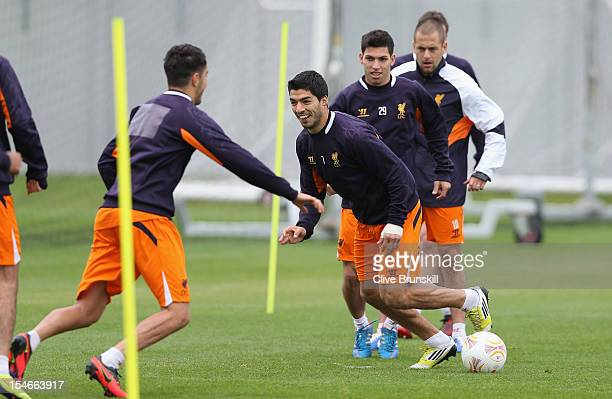 Luis Suarez of Liverpool enjoying a training session ahead of their UEFA Europa League group match against FC Anzhi Makhachkala at Melwood Training...