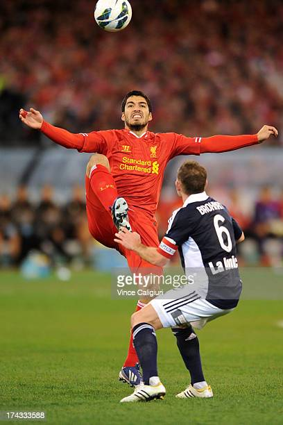 Luis Suarez of Liverpool FC and Leigh Broxham of the Victory contest for the ball during the match between the Melbourne Victory and Liverpool at...