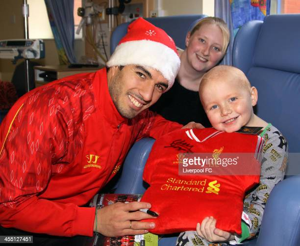 Luis Suarez of Liverpool FC visits patients at Alder Hey Children's Hospital on December 11 2013 in Liverpool England