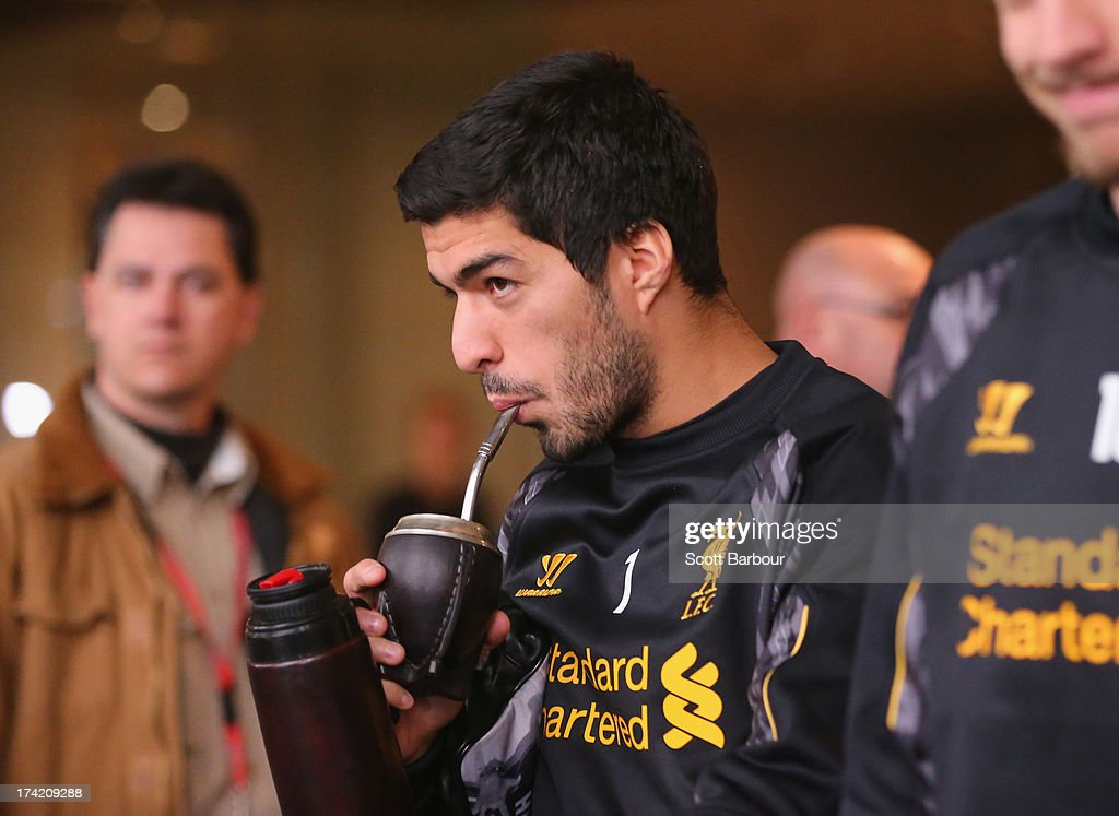 Luis Suarez of Liverpool FC walks to the team bus to attend training at the Grand Hyatt on July 22, 2013 in Melbourne, Australia.