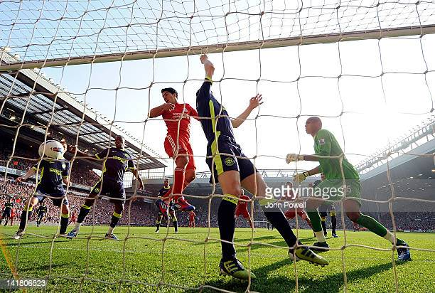 Luis Suarez of Liverpool has a goal disallowed during the Barclays Premier League match between Liverpool and Wigan at Anfield on March 24 2012 in...
