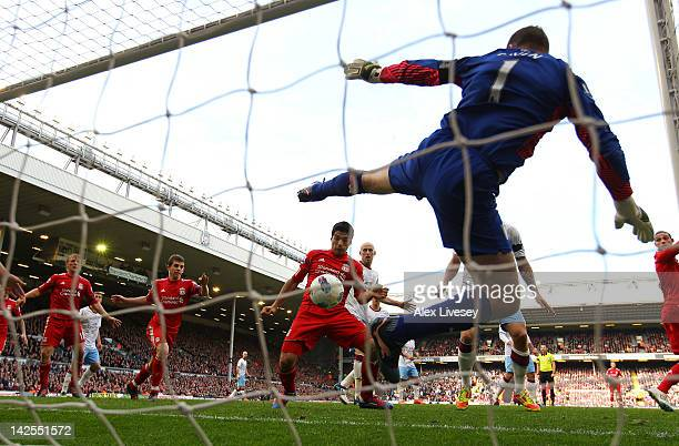 Luis Suarez of Liverpool heads in the equalizing goal past Shay Given of Aston Villa during the Barclays Premier League match between Liverpool and...