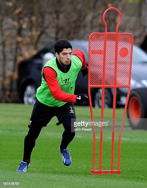 Luis Suarez of Liverpool in aciton during a training session at Melwood Training Ground on April 25 2013 in Liverpool England