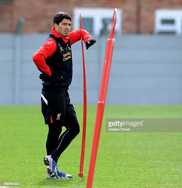 Luis Suarez of Liverpool in action during a training session at Melwood Training Ground on April 19 2013 in Liverpool England