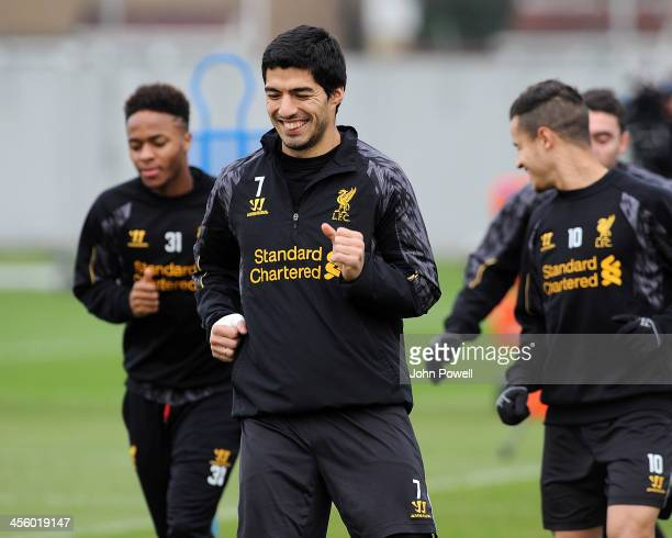 Luis Suarez of Liverpool in action during a training session at Melwood Training Ground on December 13 2013 in Liverpool England