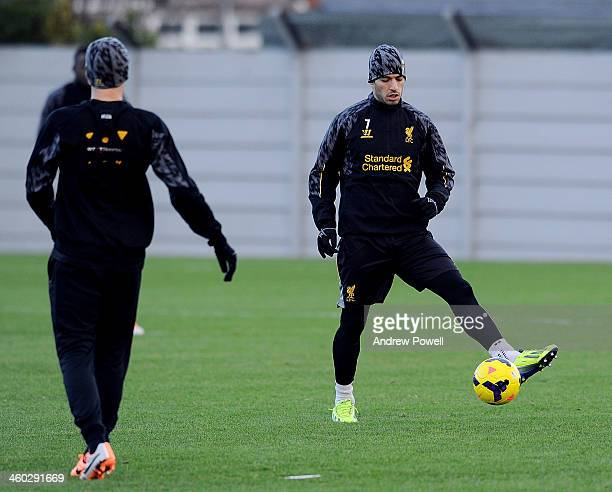 Luis Suarez of Liverpool in action during a training session at Melwood Training Ground on January 3 2014 in Liverpool England