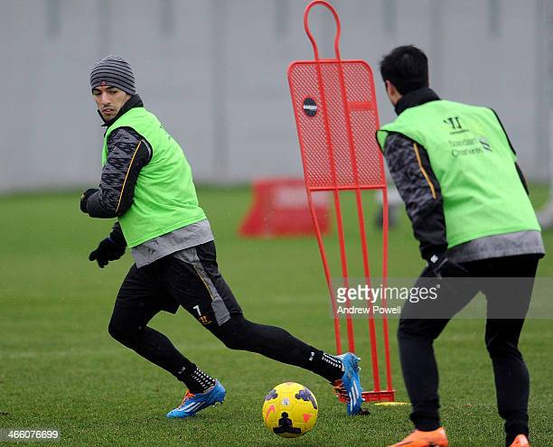 Luis Suarez of Liverpool in action during a training session at Melwood Training Ground on January 31 2014 in Liverpool England
