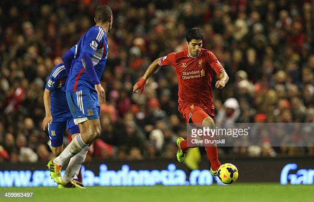 Luis Suarez of Liverpool in action during the Barclays Premier League match between Liverpool and Hull City at Anfield on January 1 2014 in Liverpool...