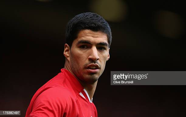 Luis Suarez of Liverpool in action during the Steven Gerrard Testimonial Match between Liverpool and Olympiacos at Anfield on August 03 2013 in...