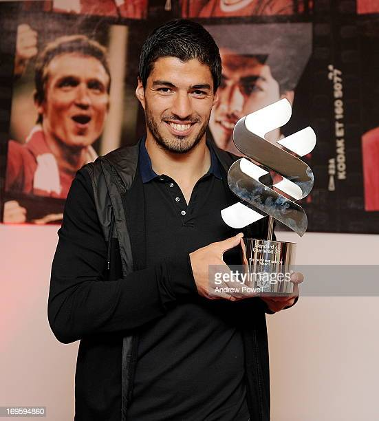 Luis Suarez of Liverpool is awarded the Standard Chartered Player of the Season award for 2012/13 Season at Melwood Training Ground on May 20 2013 in...