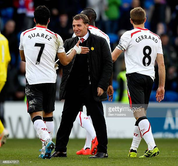 Luis Suarez of Liverpool is congratulated by his manager Brendan Rogers after the final whistle during the Barclays Premier League match between...