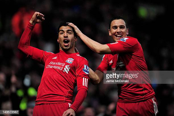 Luis Suarez of Liverpool is congratulated by teammate Stewart Downing after scoring his team's thord goal during the Barclays Premier League match...