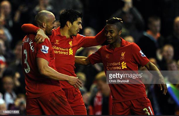 Luis Suarez of Liverpool is congratulated by team-mates Raheem Sterling and Jose Enrique after scoring the opening goal during the Barclays Premier...
