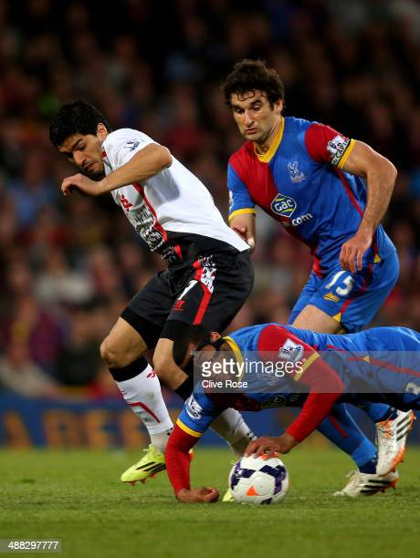 Luis Suarez of Liverpool is dispossessed as Adrian Mariappa of Crystal Palace handles the ball on the floor during the Barclays Premier League match...