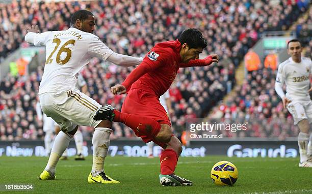Luis Suarez of Liverpool is fouled for a penalty by Kemy Agustien of Swansea City during the Barclays Premier League match between Liverpool and...
