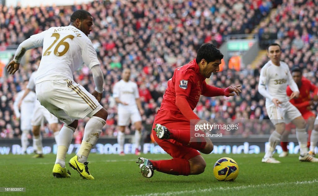 Luis Suarez of Liverpool is fouled for a penalty by Kemy Agustien of Swansea City during the Barclays Premier League match between Liverpool and Swansea City at Anfield on February 17, 2013 in Liverpool, England.