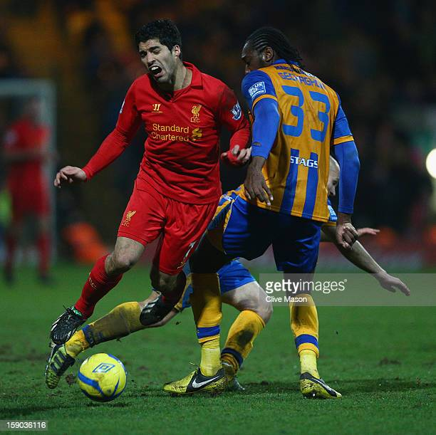 Luis Suarez of Liverpool is tackled by Exodus Geohaghon of Mansfield Town during the FA Cup with Budweiser Third Round match between Mansfield Town...