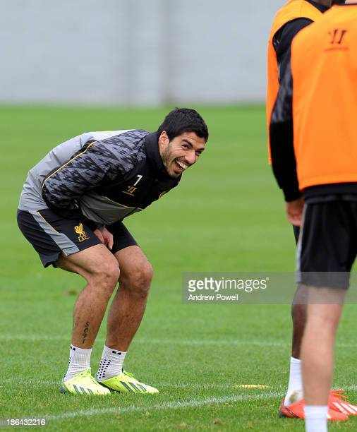 Luis Suarez of Liverpool laughing during a training session at Melwood Training Ground on October 31 2013 in Liverpool England