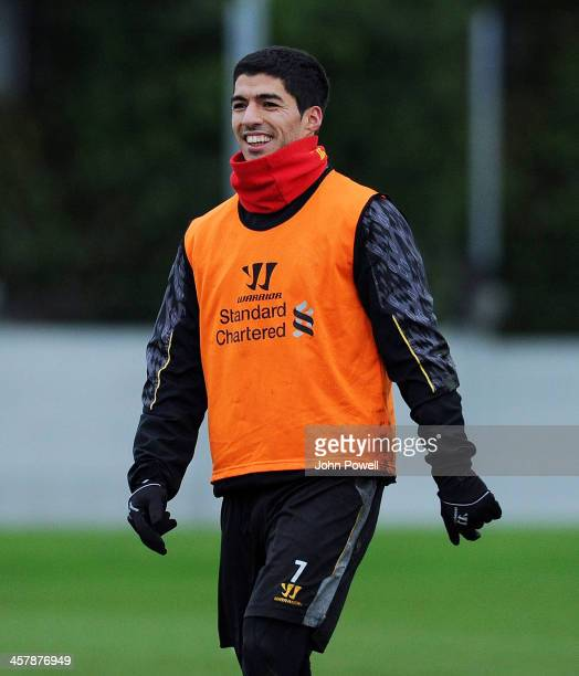 Luis Suarez of Liverpool laughing during a training session at Melwood Training Ground on December 19 2013 in Liverpool England