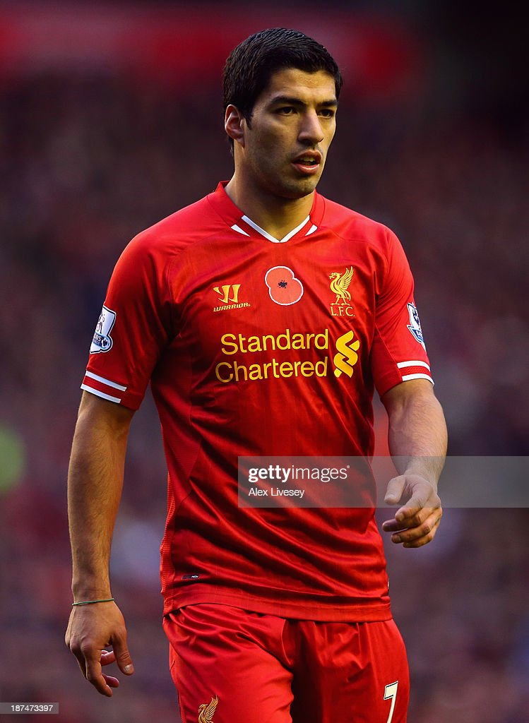 Luis Suarez of Liverpool looks on during the Barclays Premier League match between Liverpool and Fulham at Anfield on November 9, 2013 in Liverpool, England.