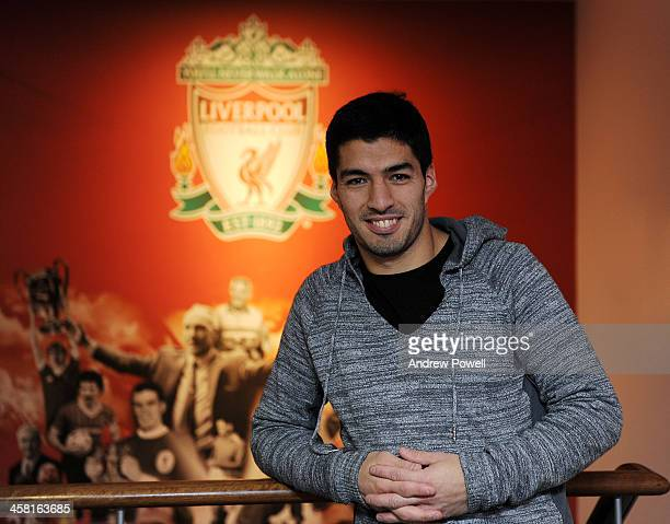 OUT Luis Suarez of Liverpool poses for a photo after signing a new long term contract for the club at Melwood Training Ground on December 20 2013 in...