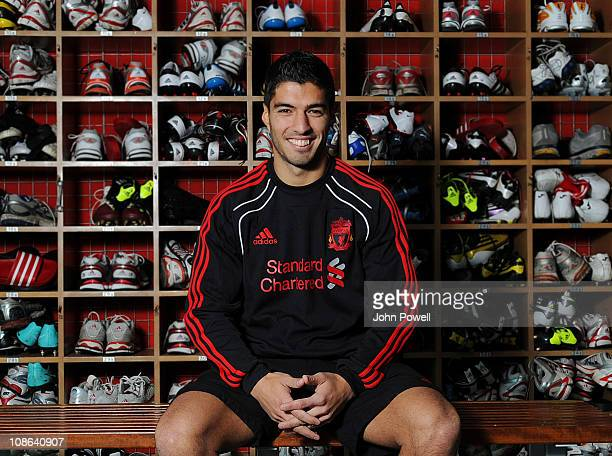 Luis Suarez of Liverpool poses for a photograph as he attends Melwood training ground for a medical ahead of signing for Liverpool Football Club on...