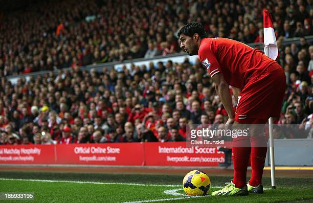 Luis Suarez of Liverpool prepares to take a corner during the Barclays Premier League match between Liverpool and West Bromwich Albion at Anfield on...