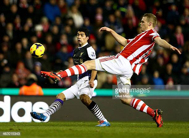 Luis Suarez of Liverpool pressures Ryan Shawcross of Stoke City to score their second goal during the Barclays Premier League match between Stoke...