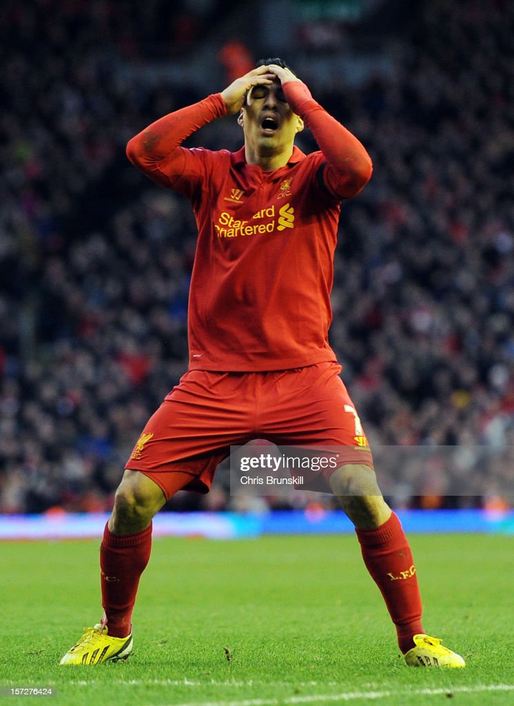 Luis Suarez of Liverpool reacts during the Barclays Premier League match between Liverpool and Southampton at Anfield on December 1, 2012 in Liverpool, England.