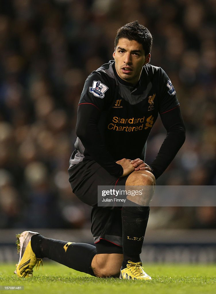 Luis Suarez of Liverpool reacts to a missed opportunity during the Barclays Premier League match between Tottenham Hotspur and Liverpool at White Hart Lane on November 28, 2012 in London, England.