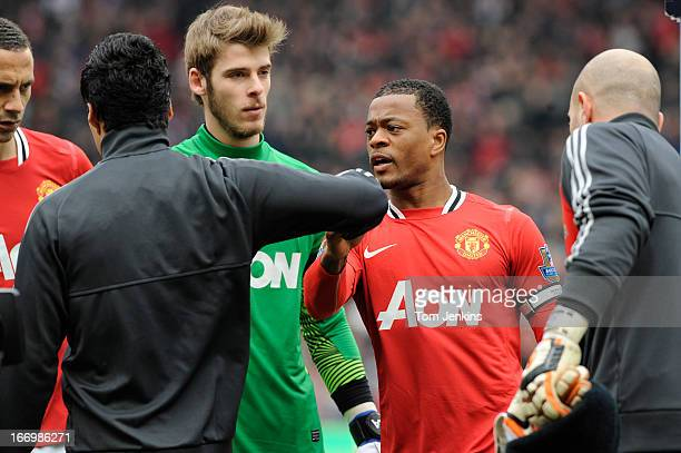Luis Suarez of Liverpool refuses to shake the hand of Patrice Evra of Manchester United ahead of the Barclays Premier League match between Manchester...