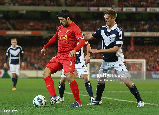 Luis Suarez of Liverpool runs with the ball during the match between the Melbourne Victory and Liverpool at the Melbourne Cricket Ground on July 24,...