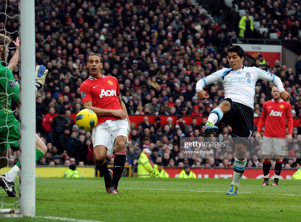 Luis Suarez of Liverpool scores a goal making it 2-1 during the Barclays Premier League match between Manchester United and Liverpool at Old Trafford on February 11, 2012 in Manchester, England.