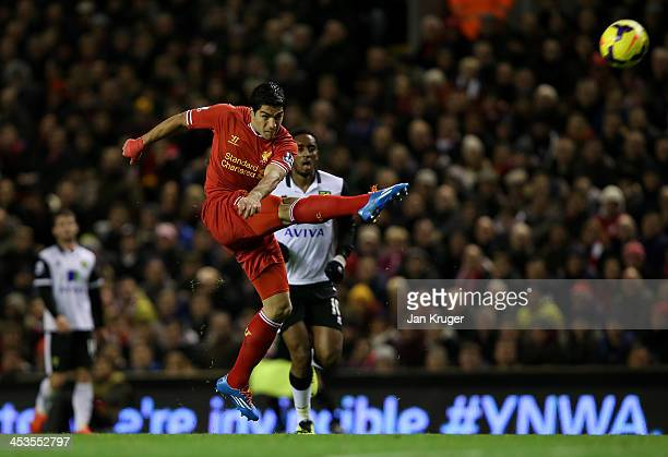 Luis Suarez of Liverpool scores his first goal from a long range effort during the Barclays Premier League match between Liverpool and Norwich City...