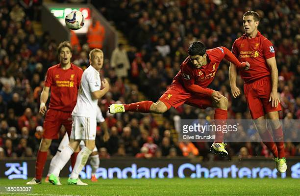 Luis Suarez of Liverpool scores his team's first goal during the Capital One Cup Fourth Round match between Liverpool and Swansea City at Anfield on...