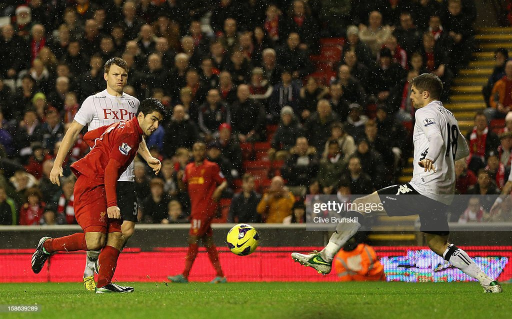 Luis Suarez of Liverpool scores his team's fourth goal during the Barclays Premier League match between Liverpool and Fulham at Anfield on December 22, 2012 in Liverpool, England.