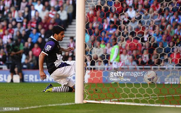 Luis Suarez of Liverpool scores his team's second goal during the Barclays Premier League match between Sunderland and Liverpool at the Stadium of...