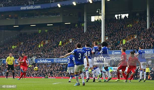 Luis Suarez of Liverpool scores his team's second goal during the Barclays Premier League match between Everton and Liverpool at Goodison Park on...