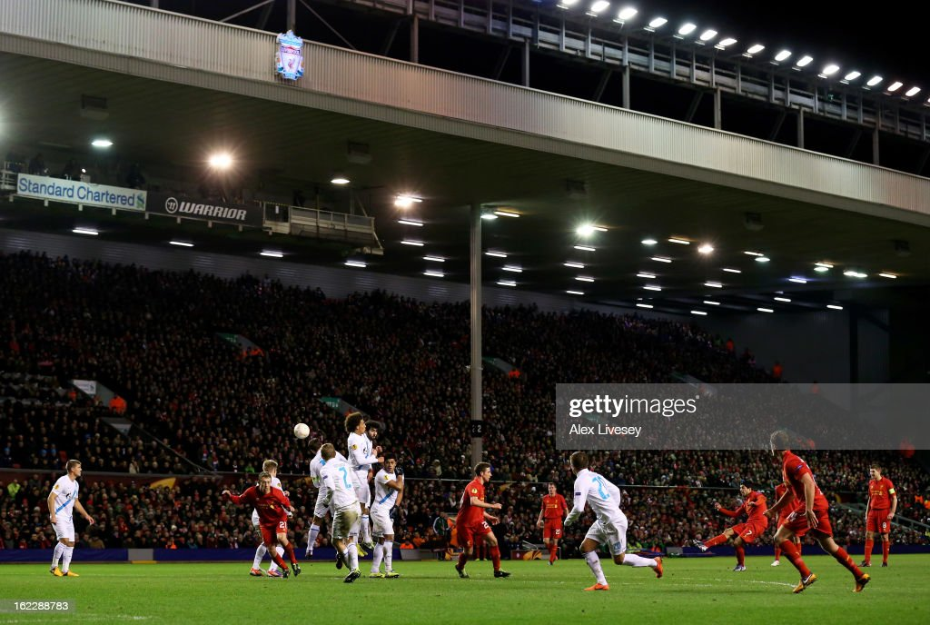 Luis Suarez of Liverpool scores his team's third goal from a free kick during the UEFA Europa League round of 32 second leg match between Liverpool FC and FC Zenit St Petersburg at Anfield on February 21, 2013 in Liverpool, England.