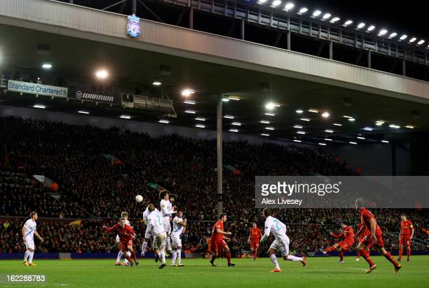 Luis Suarez of Liverpool scores his team's third goal from a free kick during the UEFA Europa League round of 32 second leg match between Liverpool...