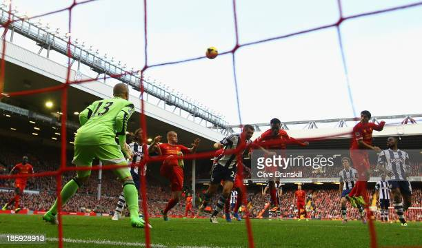 Luis Suarez of Liverpool scores his team's third goal to complete his hattrick during the Barclays Premier League match between Liverpool and West...