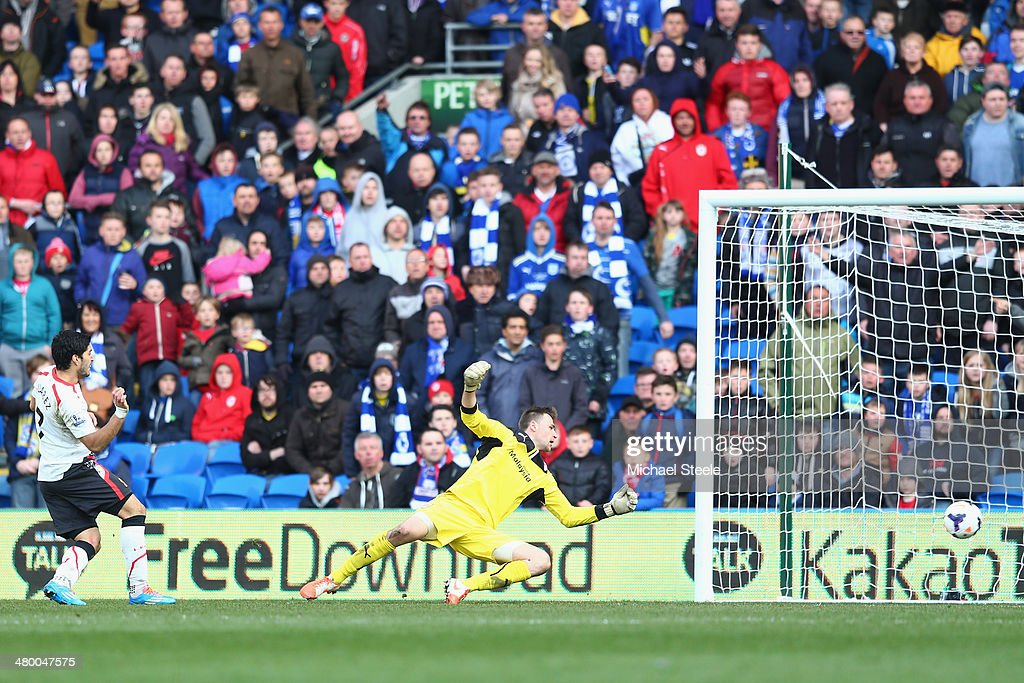 Luis Suarez (L) of Liverpool scores his third goal and his teams sixth during the Barclays Premier League match between Cardiff City and Liverpool at the Cardiff City Stadium on March 22, 2014 in Cardiff, Wales.