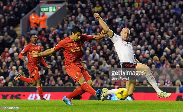 Luis Suarez of Liverpool scores his third goal during the Barclays Premier League Match between Liverpool and Fulham at Anfield on November 9 2013 in...