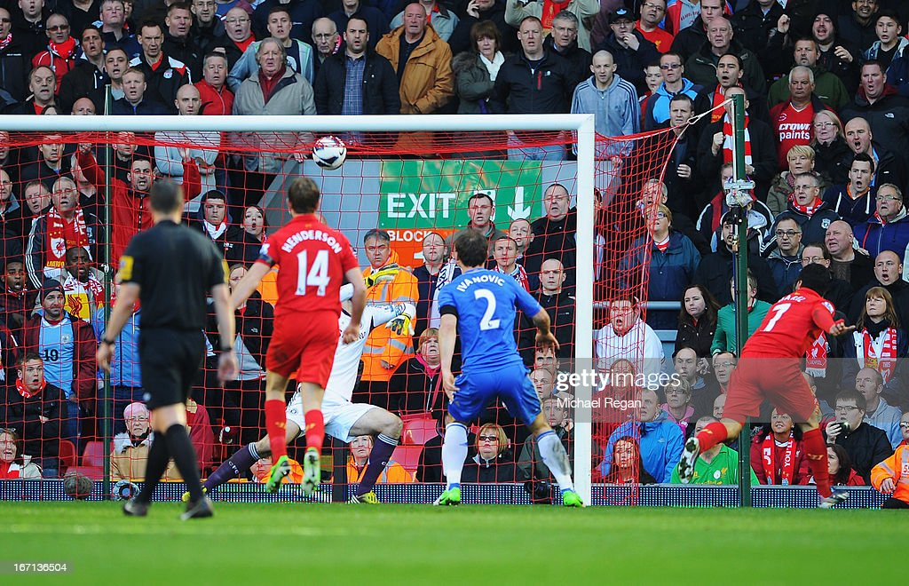 Luis Suarez of Liverpool scores the equalising goal during the Barclays Premier League match between Liverpool and Chelsea at Anfield on April 21, 2013 in Liverpool, England.