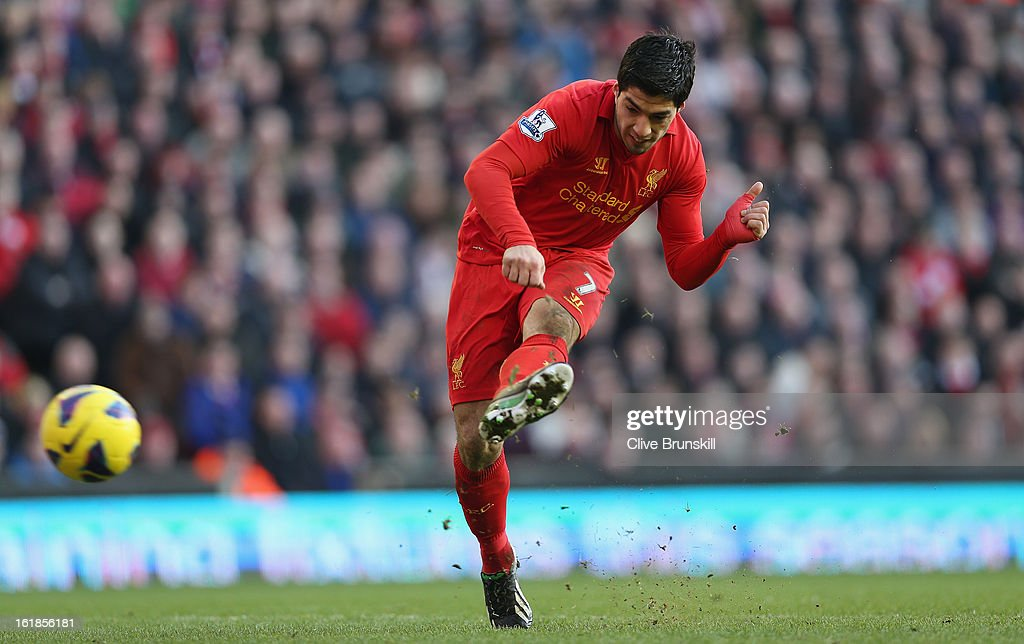 Luis Suarez of Liverpool scores the fourth goal during the Barclays Premier League match between Liverpool and Swansea City at Anfield on February 17, 2013 in Liverpool, England.