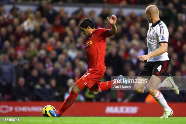 Luis Suarez of Liverpool scores the fourth goal during the Barclays Premier League match between Liverpool and Fulham at Anfield on November 9 2013...